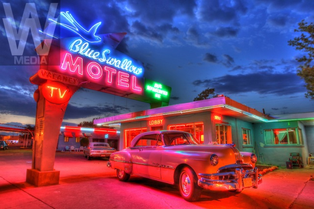 Route 66-New Mexico- A 1951 Pontiac Eight is illuminated by the neon lights of the Art Deco-styled Blue Swallow Motel along Route 66 in Tucumcari, New Mexico. Photo by Colin E Braley